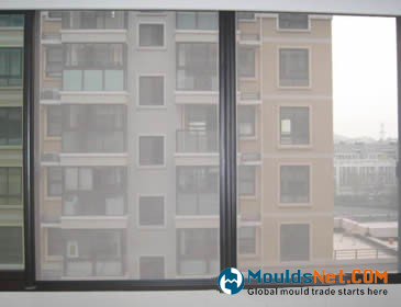 Stainless steel woven wire cloth is installed on the windows of residence.