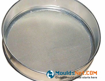 A stainless steel test sieve on the white background.