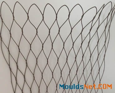 A piece of stainless steel knotted rope mesh hangs on the wall.