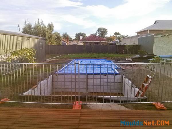 Temporary pool fencing are enclosing a pool co<em></em>nstruction site.